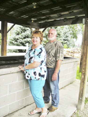 Submitted Photo Paula and Bruce Gustafson will spend most of their time this week preparing and serving nearly 3,000 of the traditional beef barbecue dinners at the 73rd annual Gerry Rodeo.