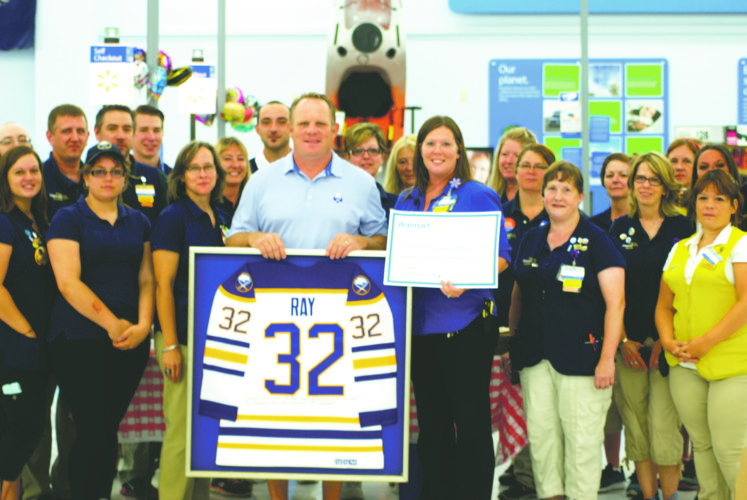 OBSERVER Photo by Jared Hill Former Buffalo Sabre Rob Ray is pictured, surrounded by Wal-Mart employees and representatives of Women and Children's Hospital on Monday.