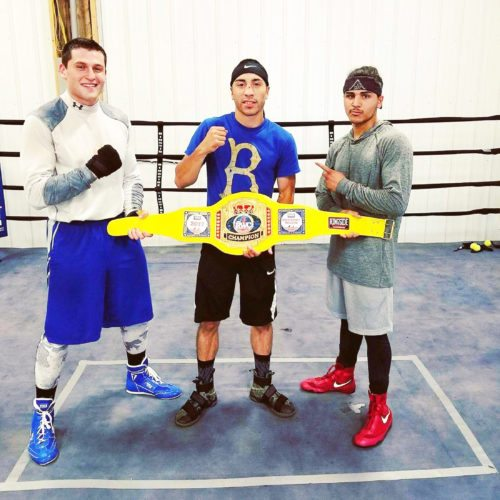 Submitted Photo Pictured is Nick Barlette (left), Elon DeJesus and Giovanni Diaz (right) holding the 2017 Ringside World Championship belt. DeJesus won the 123-pound bantamweight class title last week in Independence, Missouri.