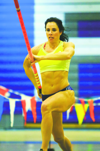 OBSERVER File Photo: Jenn Suhr prepares for a vault with her trusty companion vaulting pole in 2015.