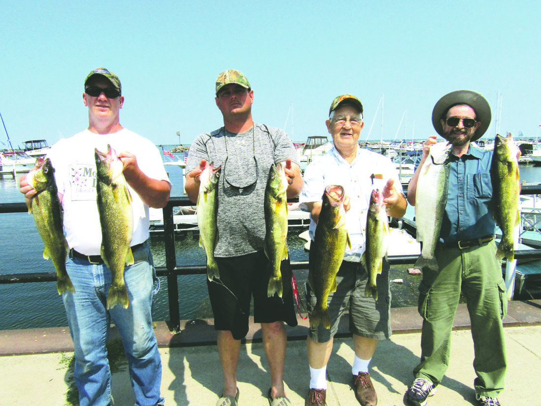 OBSERVER Photo by Gene Pauszek Pictured from left are Steve Colley, Ron Duliba, Leon Archer and Wade Robertson display part of their catch during the 2017 VIP day on Lake Erie, Wednesday morning.