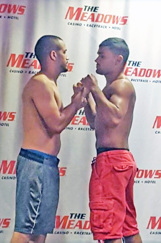 Submitted Photo Pictured is Dunkirk native Ivan Hernandez (left) and Eric Palmer staring each other down during the weigh-ins the day before their fight last Saturday at WFC 76.
