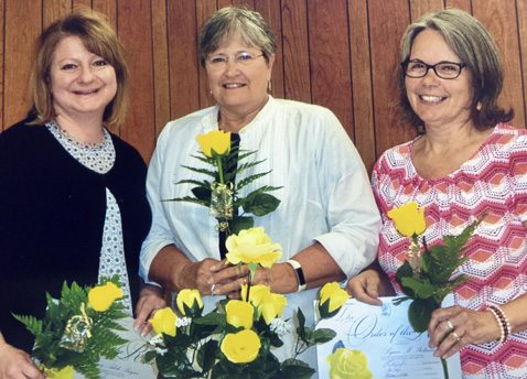 Submitted Photo: Amy Begier (left), Carol Best (center) and Lynn Stetson (right) are awarded the Order of the Rose for over 15 years of outstanding membership in Beta Sigma Phi. The award was presented at the May meeting of the Laureate Alpha Pi chapter in Westfield.