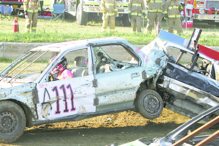 Emily Dillenburg, of Forestville, in car A111, is seen causing some damage in the A Heat of July 25's Chautauqua County Fair Demolition Derby. Dillenburg was one of the winners of that heat and moved on to the Sunday championships.