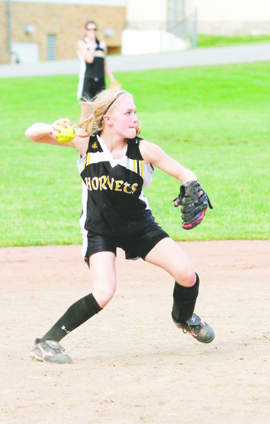 Dillenburg makes a throw to first during her days as a Forestville Hornet.