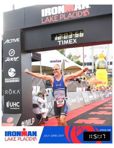 Submitted Photo On July 23, local resident, Mark Wilson, completed his 10th Ironman Triathlon in Lake Placid. An Ironman consists of a 2.4 mile swim, 112 mile bike and a 26.2 mile run. Mark had a finishing time of 11:51:17; this was one minute faster than his first Ironman race at the inaugural Ironman Lake Placid 19 years ago. Mark grew up in Mayville and graduated from Westfield High School and SUNY Fredonia. He has been a triathlon coach for the past 20 years, coaching athletes all around the country as well as hosting triathlon camps in beautiful venues around the country. Having just moved back to Randolph last year after 20 years in the Hudson Valley, he has started the Southern Tier Triathlon Club that hosts a Summer Tri-Series held in Cassadaga four times during the summer. You can learn more about Wilson at his website; www.CoachMarkWilson.com.