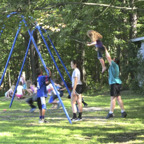 OBSERVER Photo by Damian Sebouhian: Kids play on the swings at Hanover Bicentennial Park during the end of the year youth rec picnic.