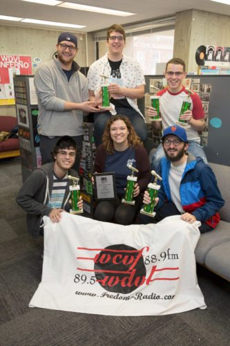 """Proudly displaying their IBS first place trophies are (front row, from left) Dan Salazar, """"Becca"""" D'Hilly and Alex Behrens; (back row, from left) Matt Pantano, Jaret Belschwinder and Noah Maciejewski (missing from the photo is Jay Wilkie)."""