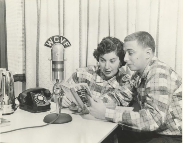 Photo courtsey of SUNY Fredonia: The adorable Barry and Estelle Greenberg, '57, in 1956, at the mic on WCVF radio at the State University of New York at Fredonia.