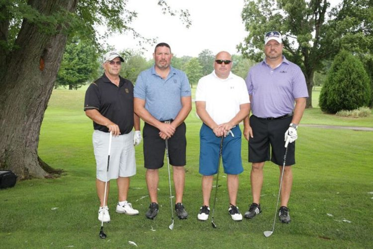 Submitted Photo: The Ninth Fredonia Alumni Golf Tournament was held July 14 at Shorewood Country Club in Dunkirk. The four-player scramble format included 21 teams of alumni, faculty and staff and friends of the university, playing on what turned out to be a beautiful afternoon. Winners included the foursome (pictured, from left) of Ken Drummond, Josh Harrington, Rob McAfee and Jeremy McAfee from Comfort Pest Control. Net proceeds from the event were nearly $9,000 to benefit the University Police Scholarship, Alumni Association Scholarships and the Fredonia College Foundation Scholar Awards. Among the many sponsors and supporters were Lake Shore Savings, LipsitzGreenScimeCambria Attorneys at Law, the Buffalo Bills, DFT Communications, West Herr Select Vehicle Purchase Plan, Basil Chevrolet Buick of Fredonia, Liberty Mutual Insurance, Star Media Group, Earth Risks Consulting (Michael P. Wilson, '71), Tyco Integrated Security, the Faculty Student Association and the Fredonia Beaver Club. The 2018 tournament is slated for Friday, July 20 at Shorewood.