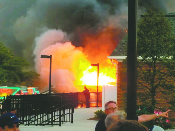 OBSERVERPhoto by Greg Fox: Allegedly, a propane tank exploded, causing this fire at the Erie County Fair on Saturday.
