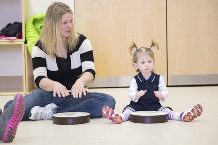Submitted Photo Children and their caregivers enjoy weekly classes of music play and exploration.