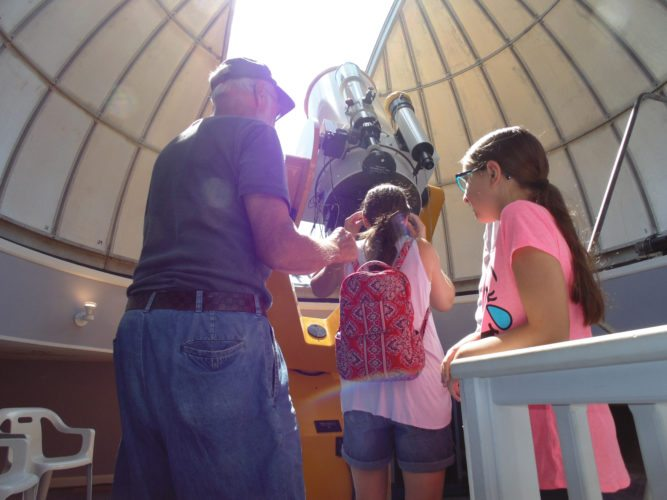 Hundreds came out to the Martz Observatory on Monday to get a glimpse of the solar eclipse. Individuals had the chance to view the eclipse inside and outside the observatory.