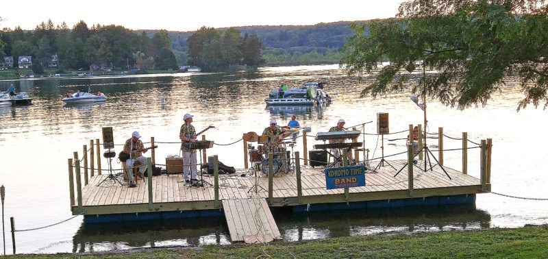Submitted Photo By popular demand, Kokomo Time Band is returning to Cassadaga Sunday, Aug. 27 at 5 p.m. Kokomo Time was the first band to perform on Cassadaga's Floating Stage on Park Avenue almost a year ago. Bring a chair, a blanket or come by boat and listen to one of the area's favorite oldies bands. Enjoy music from the Beach Boys, Jimmy Buffett and other fun summertime music. The Kiwanis will be selling hot dogs, so no need to fix dinner Sunday night. Come join the fun! This event is sponsored by the Village of Cassadaga. Pictured is last year's concert on beautiful Cassadaga Lake.