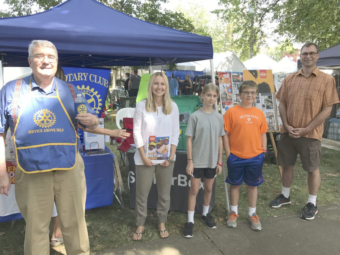 Submitted Photo: The Dunkirk-Fredonia Rotary Club had a booth over the weekend at the Fredonia Farm Festival. Manned by Rotary members and family as well as some from the community, the booth contained information on the club, Rotary, an international service organization, and the club's continued commitment to wipe out Polio. Also, the club sold tickets for its annual wine raffle. Left to right is David Tiffany, president; Susan Soja, member, Alex Reyda, Eliot Reyda, Joe Reyda, past president. The club meets Thursdays at noon at the Fredonia Beaver Club.