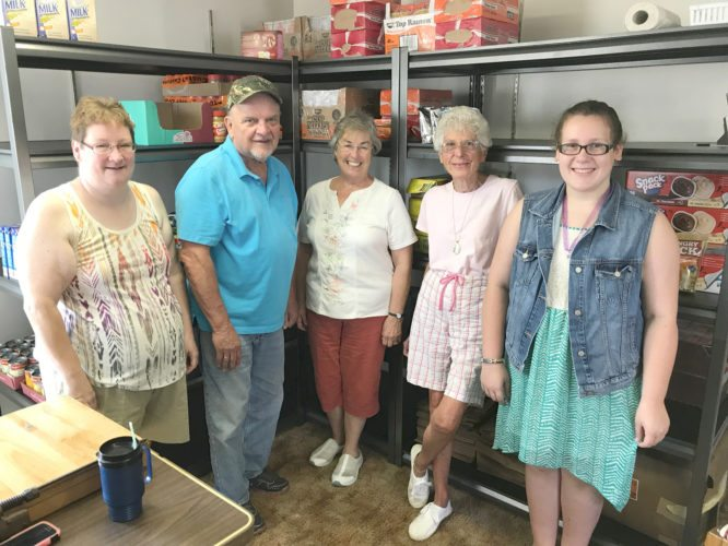 Submitted Photo  DFMOW and Brocton Tri-Church Parish Team Up for Weekend Feeding Program: left to right: Barb Crandall, Tri-Church Weekend Feeding Program Coordinator; Ed Rusch, DFMOW driver; Donna Metzger, DFMOW volunteer and board member; Jan Jarvis, Tri-Church Volunteer; and Kristi Crandall, Tri Church Volunteer.