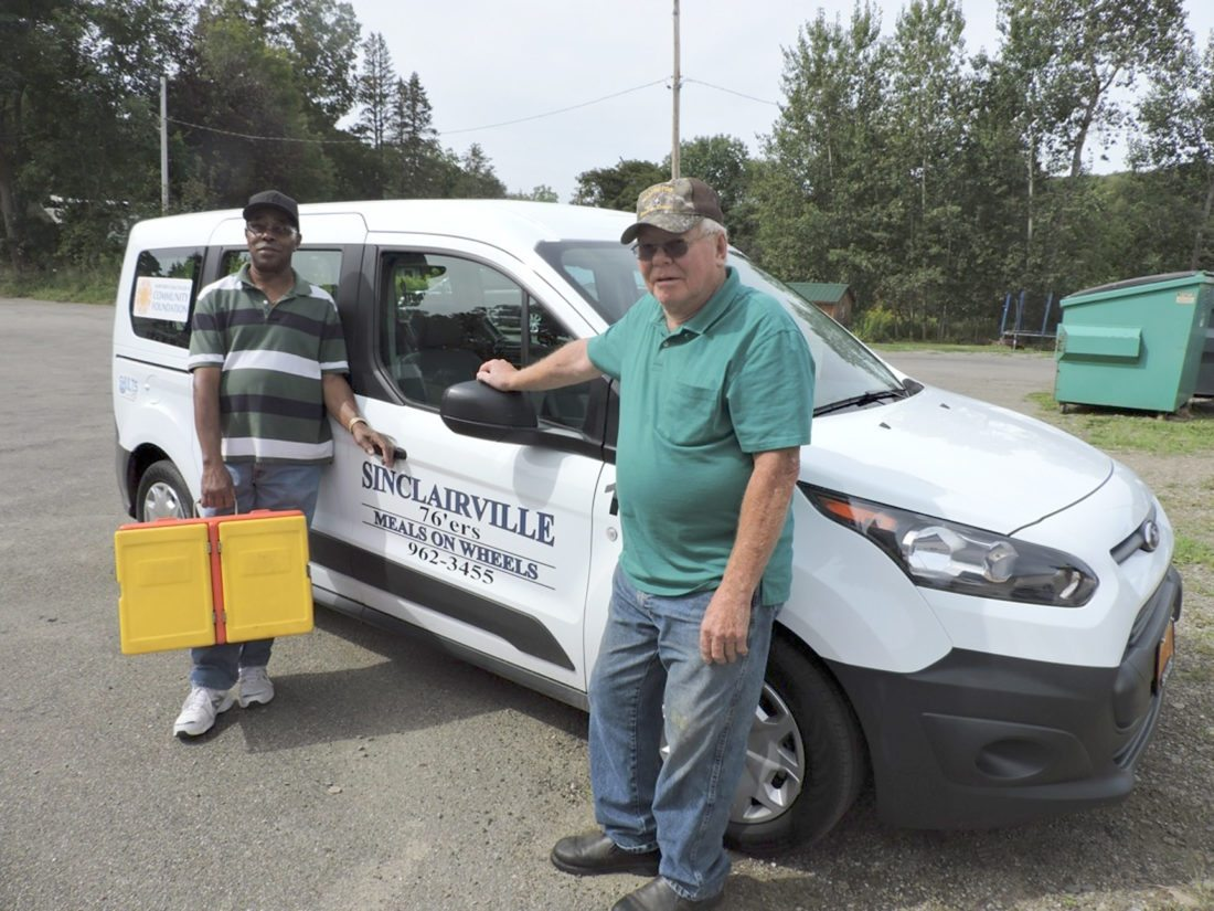 Submitted Photo The Sinclairville 76ers, through the generous support of many people, purchased a new delivery van. Shown in the photograph are volunteer driver Tommie Alford holding one of the hot boxes used to keep meals hot, and Richard Smith, president of the 76ers.