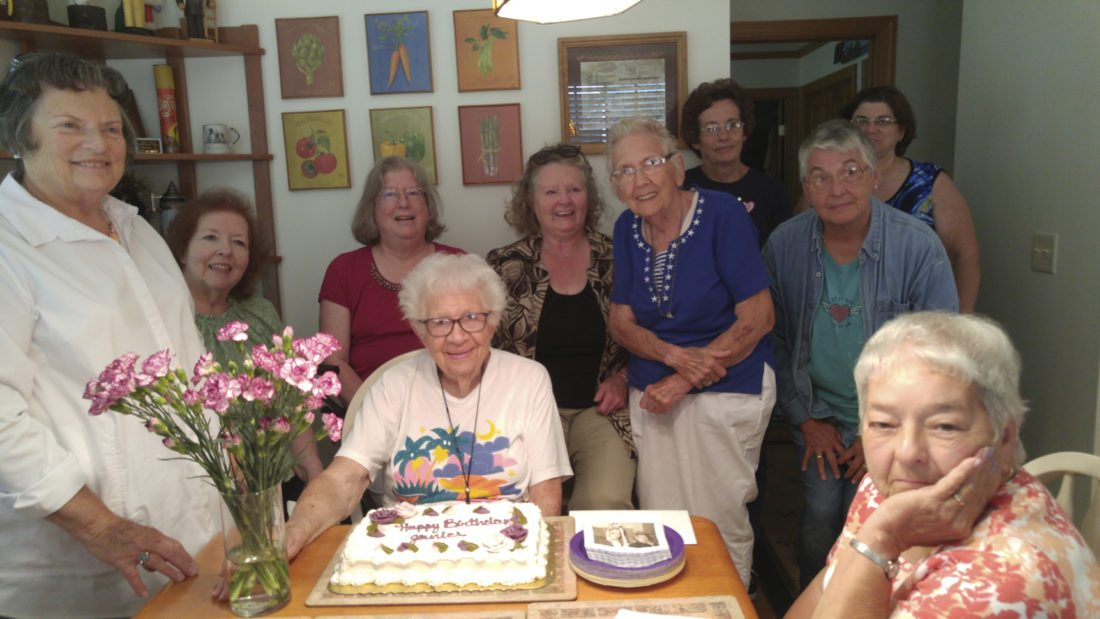 Submitted Photo: Surrounding Janice Weitz, sitting, from left to right: Carol Abell, Dawn Ubaney, Lisa Sedlmayer, Myra Johnston, Julina Harris, Phyllis Noble, (back) Bonnie Larkin, Mercy Warren, Antoniette Sherman. Present but missing from picture were Barbara Pietro and Deborah Cenni.
