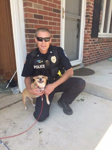 Submitted Photo With an unexpected death in our town this little pup was left without anyone to care for him. Luckily for him Evans Police Officer Scott DeJohn has a big heart and brought him into his home. As you can see he is happy to be staying with Scott.