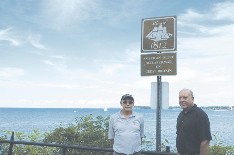 , David Briska of the Dunkirk Historical Lighthouse and John M. Kuzdale, right, stand by the War of 1812 sign.