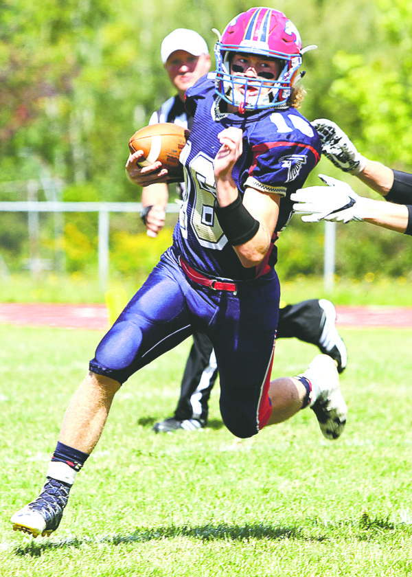 OBSERVER Photo by Lisa Monacelli: Golden Cougars' quarterback, Connor Crabtree (16), makes a play rolling out of the pocket.