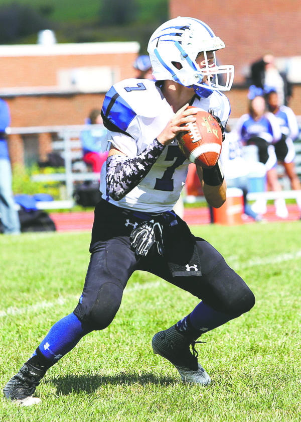 OBSERVER Photo by Lisa Monacelli: Gowanda Panthers' quarterback, Justin Kohn (7), looks to make a throw from the pocket in Saturday's 27-26 loss to Cassadaga Valley-Falconer.