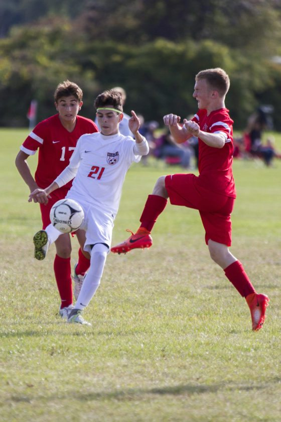 OBSERVER Photo by Lisa Monacelli Carlos Rush of Fredonia tries to move the ball through Southwestern defenders  Justin Morris, left, and Ben Livingston during Monday's high school soccer game.