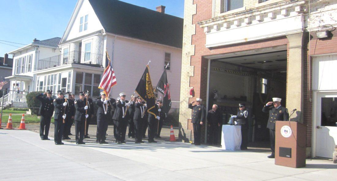 OBSERVER Photo by Diane R. Chodan Jim Muscato, president of the Dunkirk Professional Firefighters Association I.A.F.F. Local 616, rings the bell to commemorate the loss of life during the ceremony remembering 9-11. The firefighters stood at attention.
