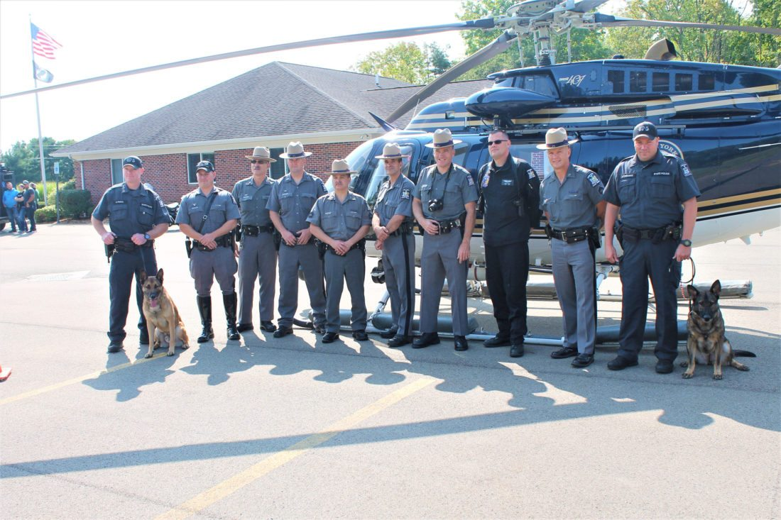 Photo by Jordan Patterson: New York State Police gather Sunday for the 100th anniversary of the law enforcement organization at the Jamestown barracks with their K-9s and helicopter.