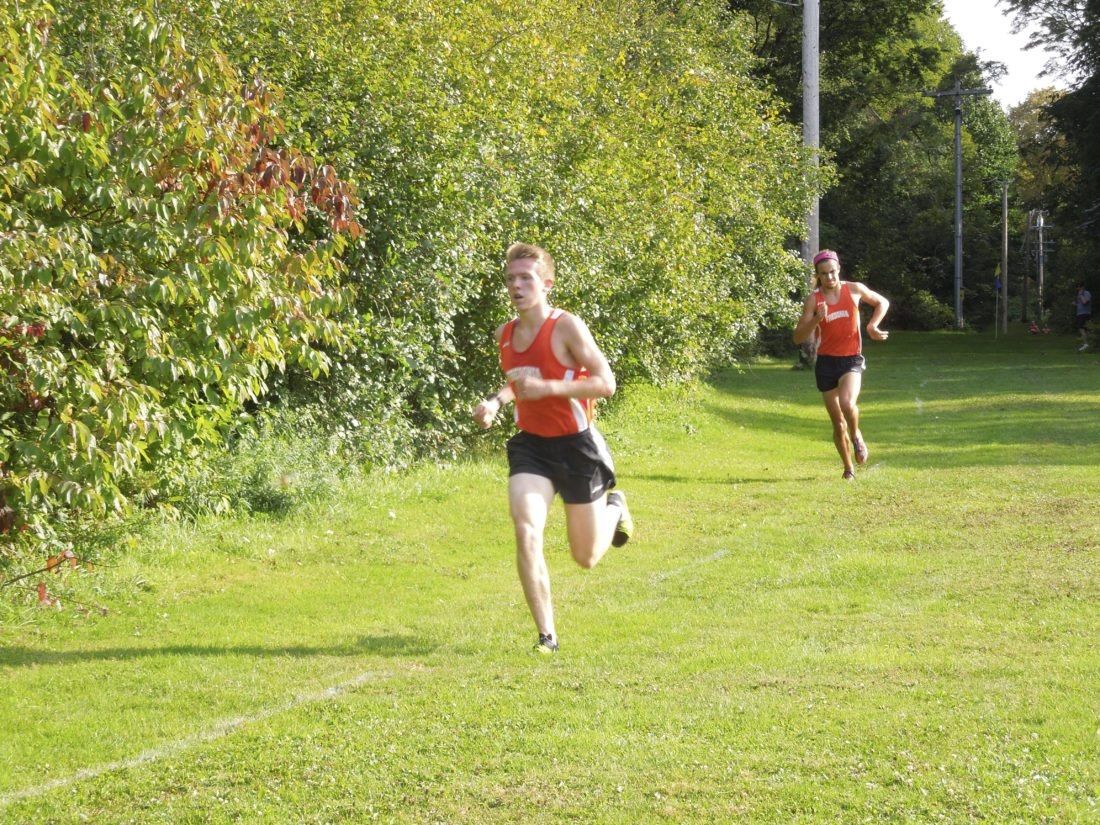 Submitted Photo Fredonia's Josh Johnson, left, and Diego Rey run during Tuesday's cross country meet at Lake Erie State Park.