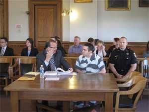 Ned Barone, Chautauqua County public defender, confers with his client, Justin Haffa, during a previous session in Chautauqua County Court.  P-J file photo by Jimmy McCarthy