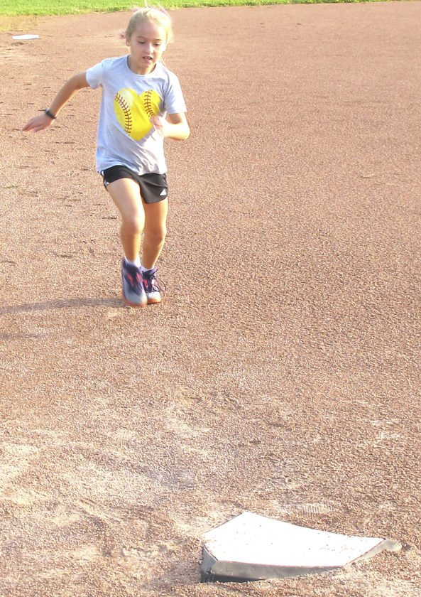 Rylee Weiskerger dashes towards home plate during the baserun competition of Tuesday's Festival of Grapes pentathlon.