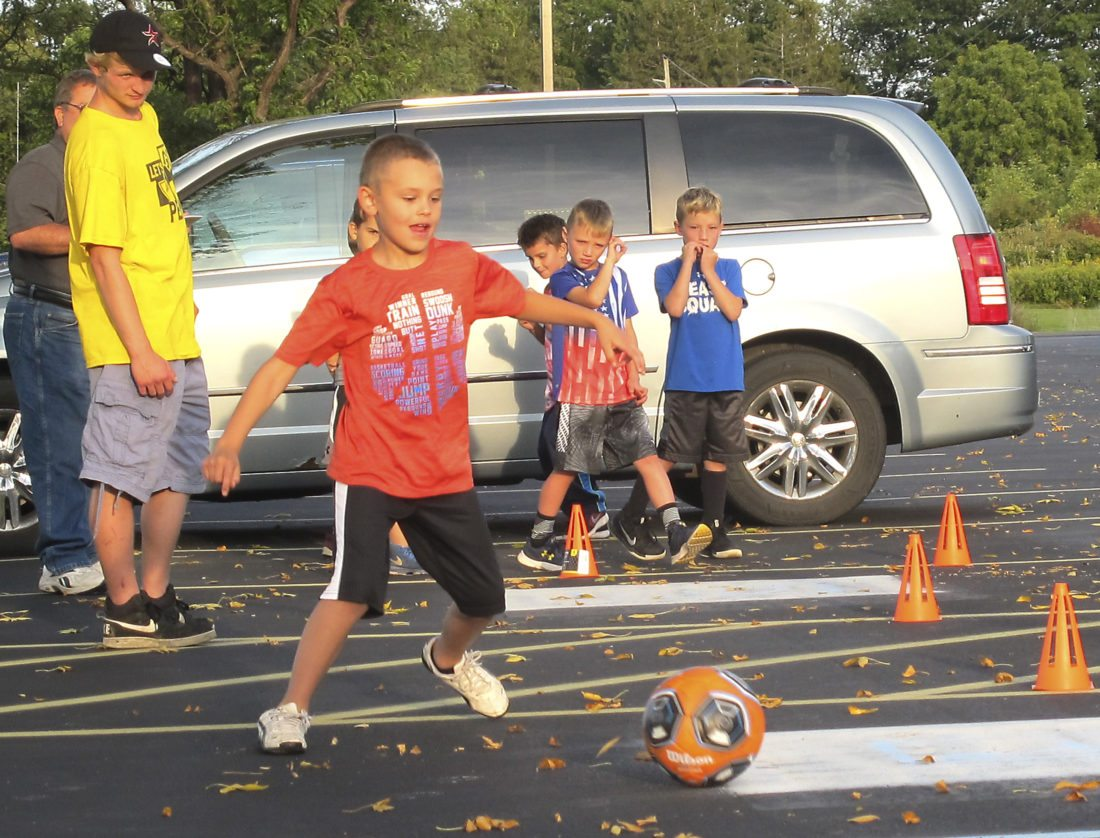 Caden Fote takes his turn during the soccer cone drill competition during Tuesday's Festival of Grapes pentathlon.