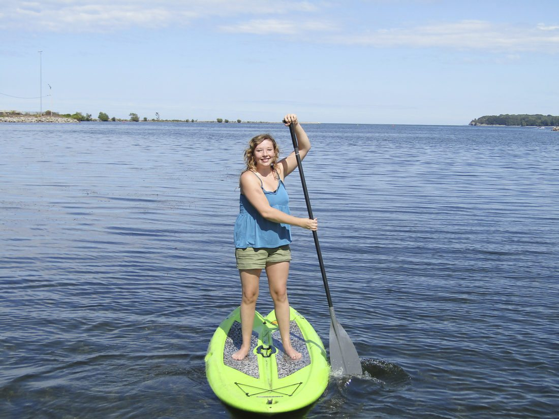 Photo by Gene Pauszek  Kelsey Gerholdt enjoyed the nice weather on Wednesday with her paddle board and her friend Jorsan Jankowski at Dunkirk Harbor.