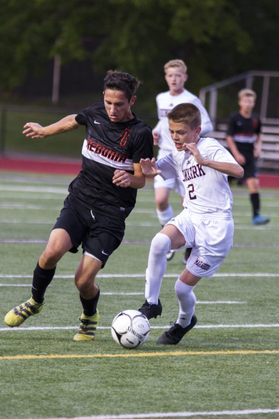 OBSERVER Photo by Mary Ann Wiberg Fredonia's Jason Genovese and Dunkirk's Trevor Skelly battle during Wednesday's boys high school soccer game in Dunkirk.
