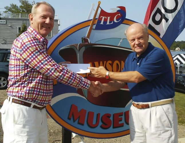Submitted Photo: David Bargar (president of TLC) is pictured congratulating Bill Locke.