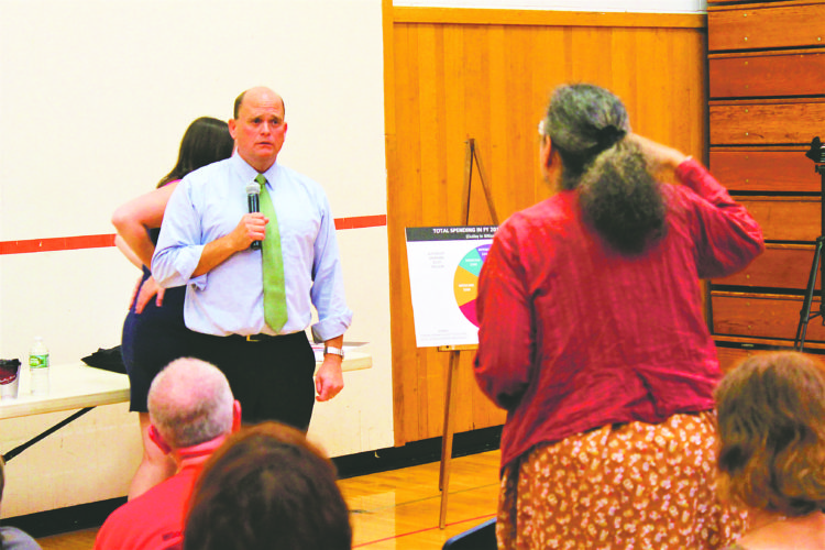 a community member delivers passionate speech about racism in America to Congressman Tom Reed during his visit to Fredonia onSaturday.