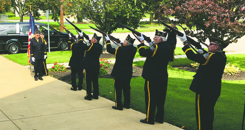 OBSERVER Photo by Andrew DavidKuczkowski: After the Memorial Mass for Dennis Stopen, a three-volley salute, pictured above, went off for Stopen, who was in the United States Navy.