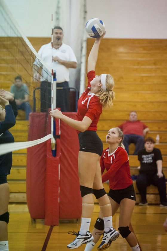 Photo by Valory Isaacson Cassadaga Valley's Jenna Caskey plays the ball at the net as teammate Savannah Nickerson watches during Monday's game.