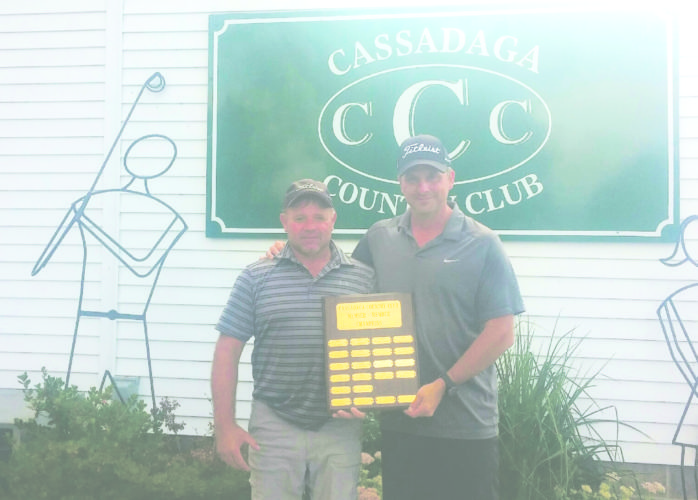 Submitted Photo Tim Bulger (left) and Todd Fenton are the 2017 Cassadaga Country Club Member-Member champions. The 27-hole triple format handicap tournament involves 9-hole rounds involving Scramble, Best Ball and Alternate Shot formats. Following the inital scramble round, Bulger and Fenton were tied for the lead with the brother team of Dan and Brad Kelly, plus the husband-wife team of Bev and Marv Cross. The second 9 holes were a best ball score. The team of Don Meder and Chip White won the round and took a two-stroke lead at 58 into the final 9-hole alternate shot round. Bulger and Fenton won the final alternate shot round and were able to secure a three-stroke victory. Meder and White finished in second place. Brad and Dan Kelly won a scorecard playoff over the team of Scott and Jared Kowalski for third and fourth, respectively. The team of Bev and Marv Cross round out the top five finishers.