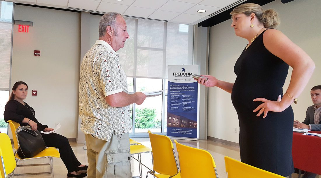 OBSERVER Photo by Nicole Gugino Bob Reuther, center, voices his concern at the Chautauqua County Industrial Development Agency public hearing for the Battery Point Villas' financial assistance. Business Development Manager Kristine Morabito, right, records his concern as Dunkirk Development Director Rebecca Yanus looks on.