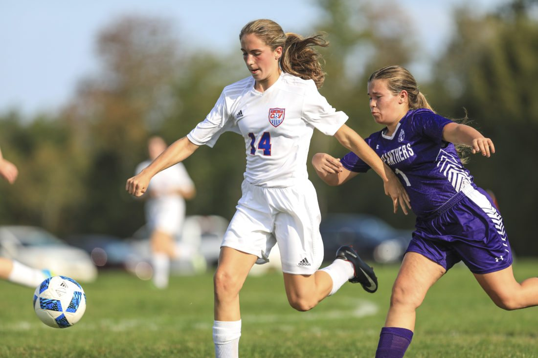OBSERVER Photo by Joe Conti: Sarah Meder of Cassadaga Valley (left) and Madisyn Herman of Pine Valley pursue the ball during Tuesday's high school soccer match.