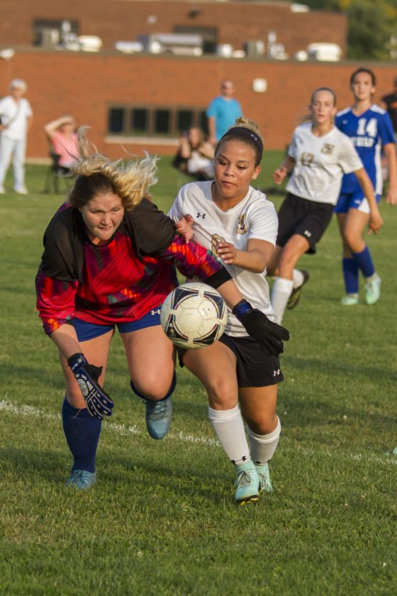 OBSERVER Photo by Mary Ann Wiberg: Westfield goalie Drew Schulz (left) and Silver Creek's Kianna Brown battle for the ball during Tuesday's soccer match.