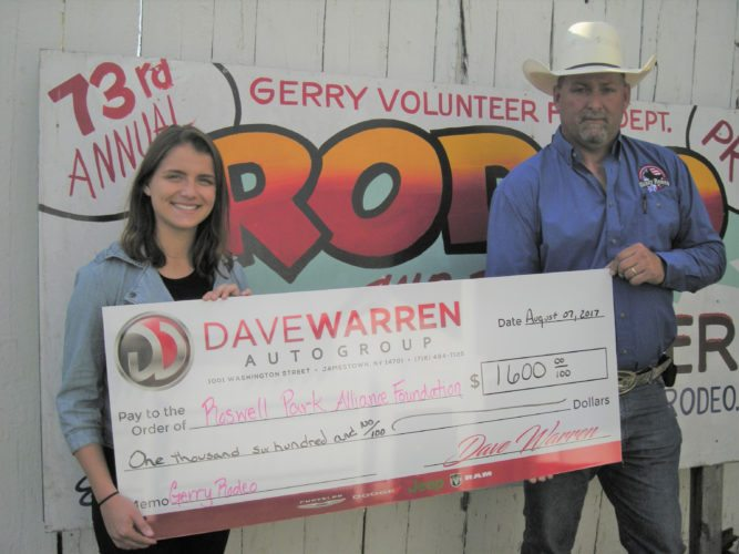 Submitted photo: Gerry Rodeo chairman Tom Atwell (right) presents a check to Alexandria Hoaglund, Special Events Coordinator at Roswell Park Cancer Institute, for money raised for breast cancer research.