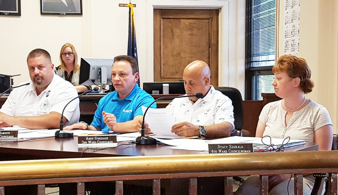 OBSERVER Photo by Nicole Gugino Pictured from left, First Ward Councilman Don Williams Jr., Second Ward councilman Marty Bamonto, Third Ward Councilman Adelino Gonzalez and Fourth Ward Councilwoman Stacy Szukala discuss the LED lighting project at Tuesday's Common Council meeting.