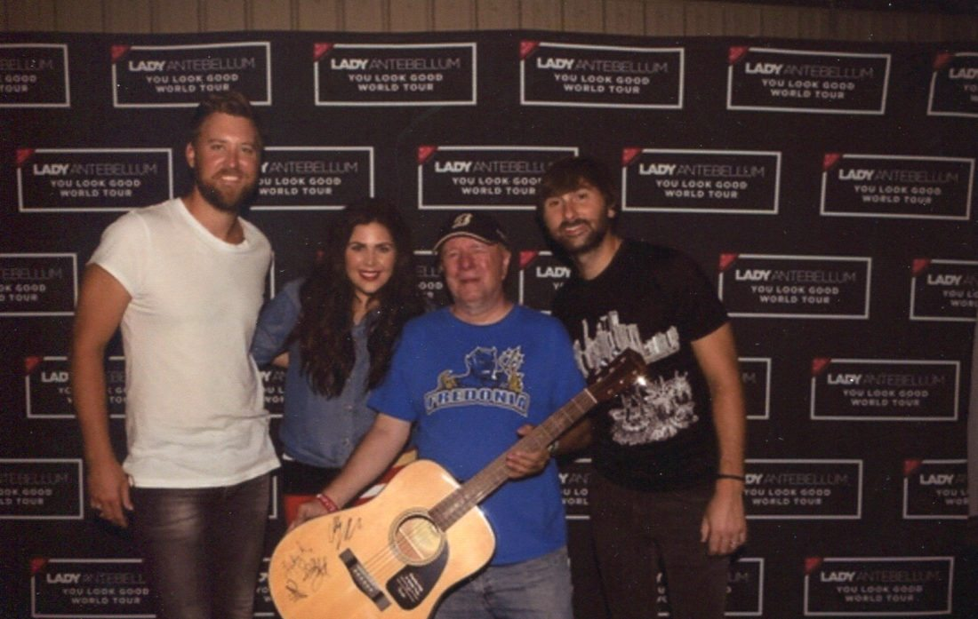 Submitted Photos A Carly's Club fundraiser will take place this Saturday at Rookies on the Lake from 2 p.m. to 1 a.m. Internationally known musicians Sarah McLachlan (top left), Lady Antebellum (above) and Kelsea Ballerini (top right) will have autographed guitars that will be part of a number of raffles.  Pictured with the musicians is Rick Kozlowski, coordinator for the Gifts of Love and Hope.