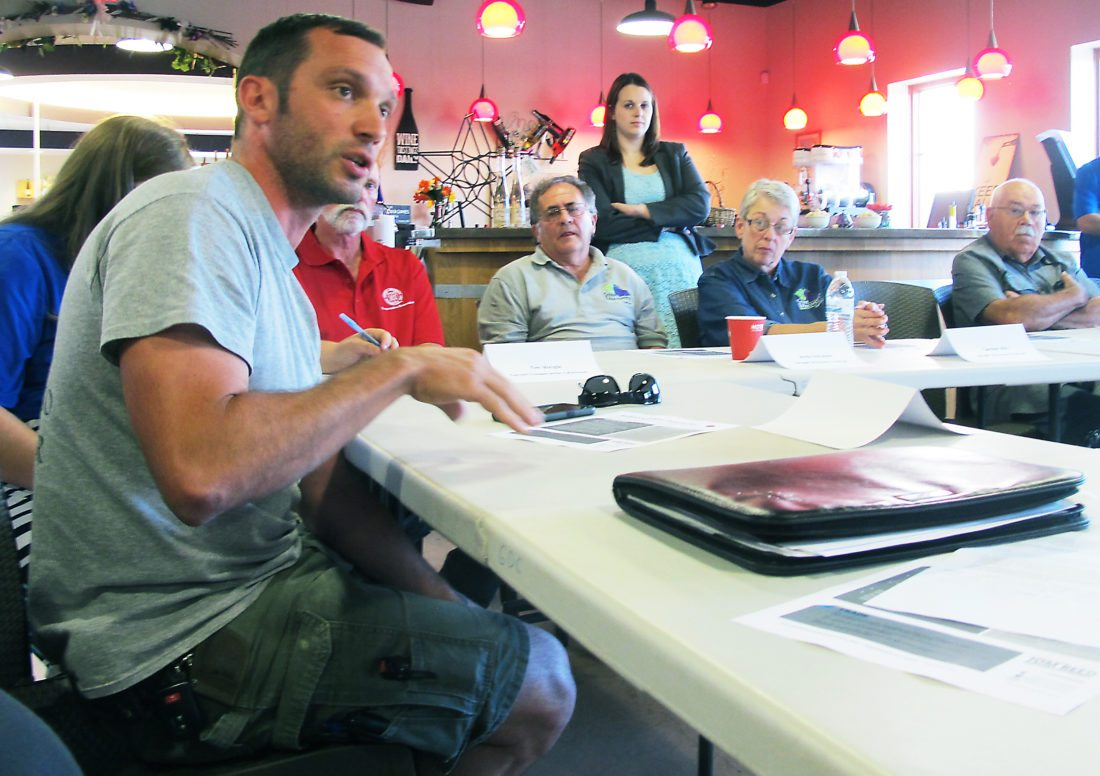 OBSERVERPhotos by Nicole Gugino At left, Mario Mazza of Mazza Chautauqua Cellars brought up issues with immigration policy at Rep. Tom Reed's roundtable in Westfield Wednesday.