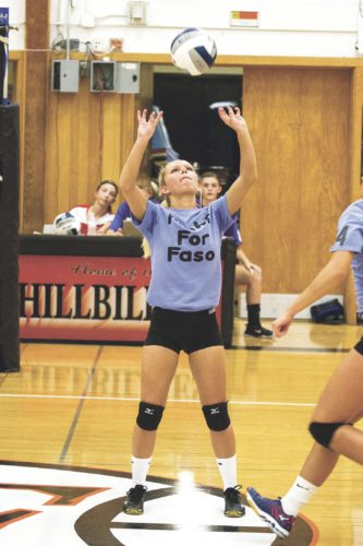OBSERVER Photo by Mary Ann Wiberg Cassadaga Valley's Savanna Nickerson sets the ball up for a spike in Thursday's win against Fredonia.