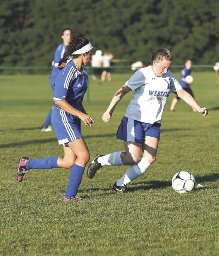 OBSERVER Photo by Roger Coda Westfield's Katie Matonic (white) plays the ball ahead of Cassadaga's Isabella Ruiz in Thursday's 4-0 win.
