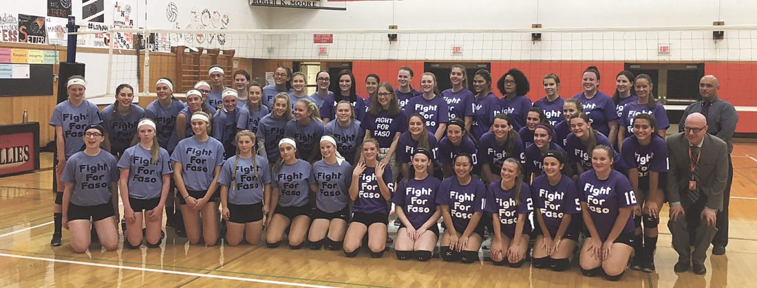 "OBSERVER photo Members of the junior varsity and varsity girls volleyball teams from Fredonia and Cassadaga Valley took part in an event to benefit a Fredonia family on Thursday afternoon. Team members wore ""Fight for Faso"" shirts as Laurie Faso, center of photo, battles stage 4 pancreatic cancer. Besides the contest, the event featured the raffling off of gift baskets, a bake sale as well as Fight for Faso bracelets. Faso worked many years in the Fredonia schools and currently works at the University at Buffalo."